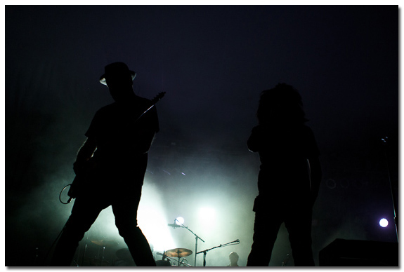 Silhouette of Counting Crows guitar player and Adam Duritz