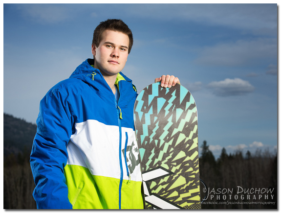 senior photo of a snowboarder