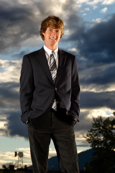 senior portrait with dramatic clouds