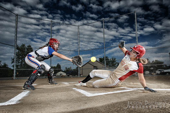 softball action portrait slide at home plate