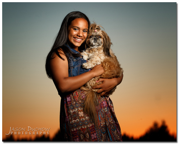 sunset senior portrait with her dog